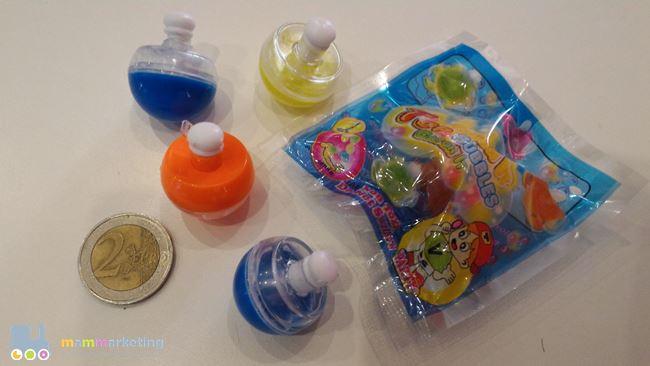 mini trottole con bolle di sapone